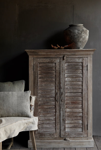 Old Indian cabinet with two louvered doors