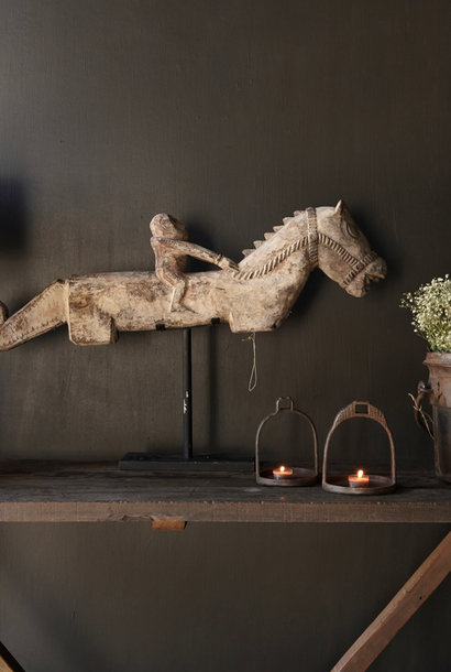 Old Unique wooden horse on an iron stand