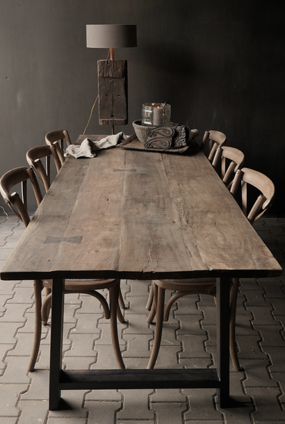 Dining table with sturdy iron leg