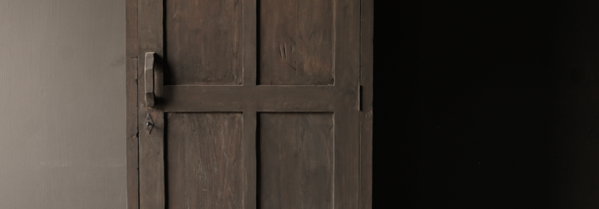 Sturdy one-door wardrobe from old wood with a drawer