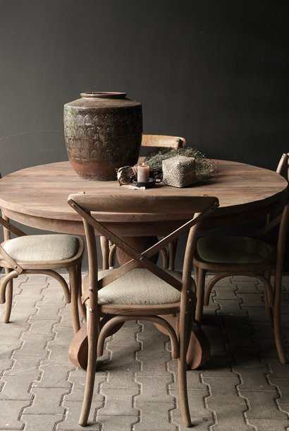 Sturdy round dark wooden table made of old used wood