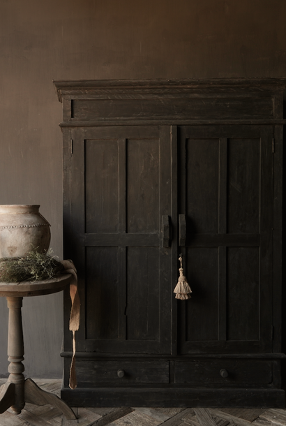 Beautifully Tough Country cupboard made of dark old wood