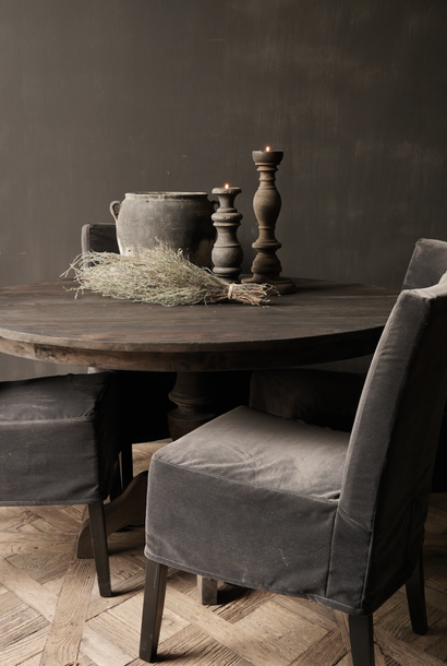 Tough round dark wooden table made of old used wood