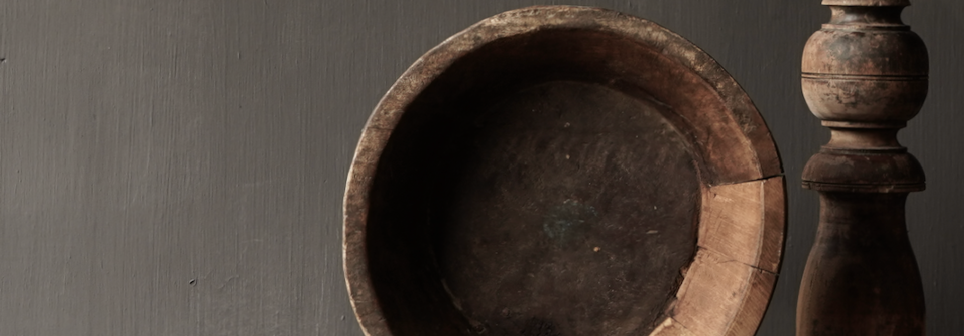 Old wooden bowl on iron base / stand
