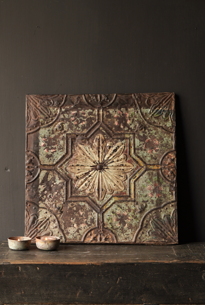 Beautiful old iron ceiling wall panel, framed in a wooden frame