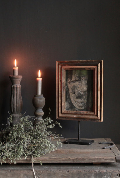 Wooden photo frame on iron tripod