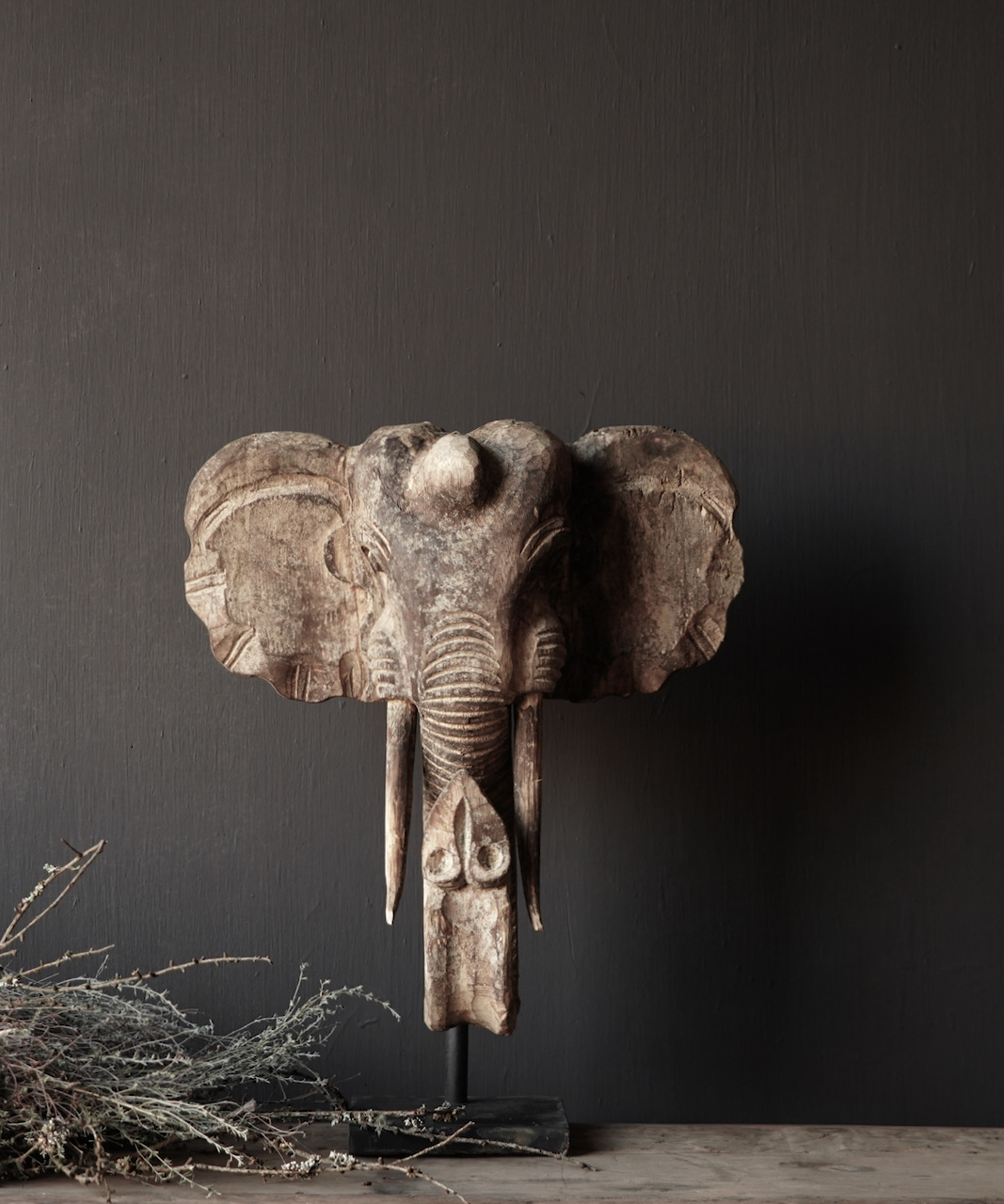 Wooden elephant head on iron stand-1