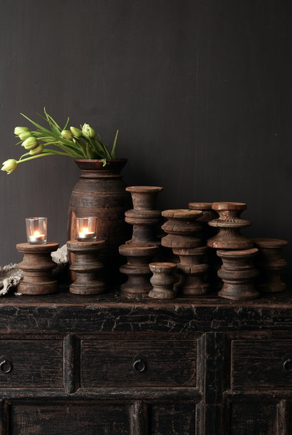 Small wooden candlestick made of old ornament