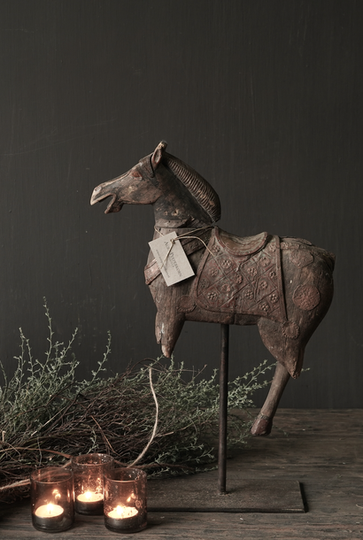 Beautiful old wooden horse on a wooden tripod