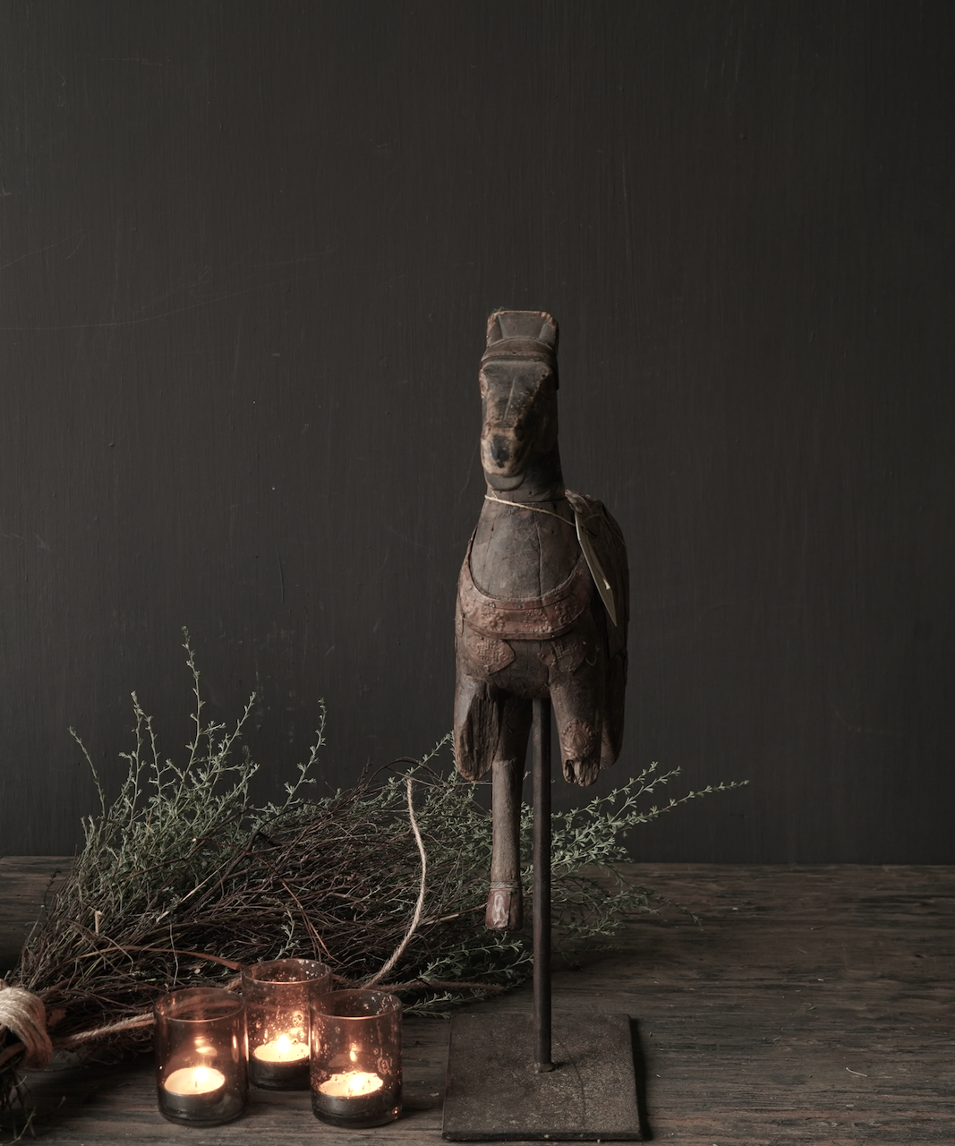 Beautiful old wooden horse on a wooden tripod-2