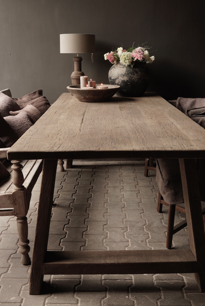 Tough old wooden dining room table with A leg