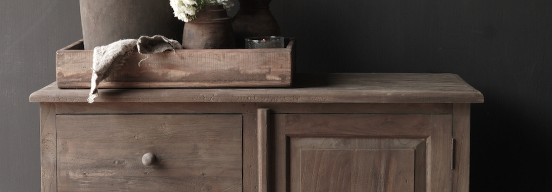 Old wooden chest of drawers with a door Lieke