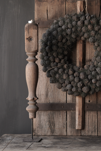 Old Wooden Baluster on an iron foot