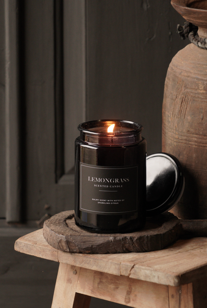 black glass Pharmacy jar filled with scented candle