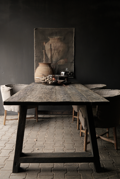 Tough dark old wooden dining room table with A leg