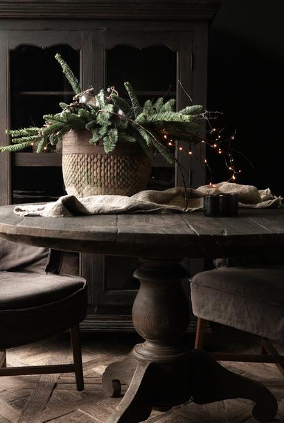 Tough robust round dark wooden table
