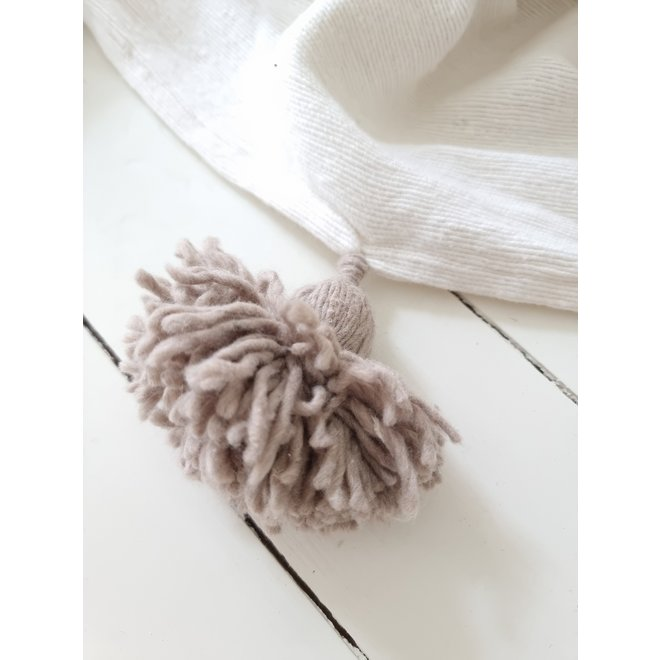Moroccan white blanket with clay grey pompoms