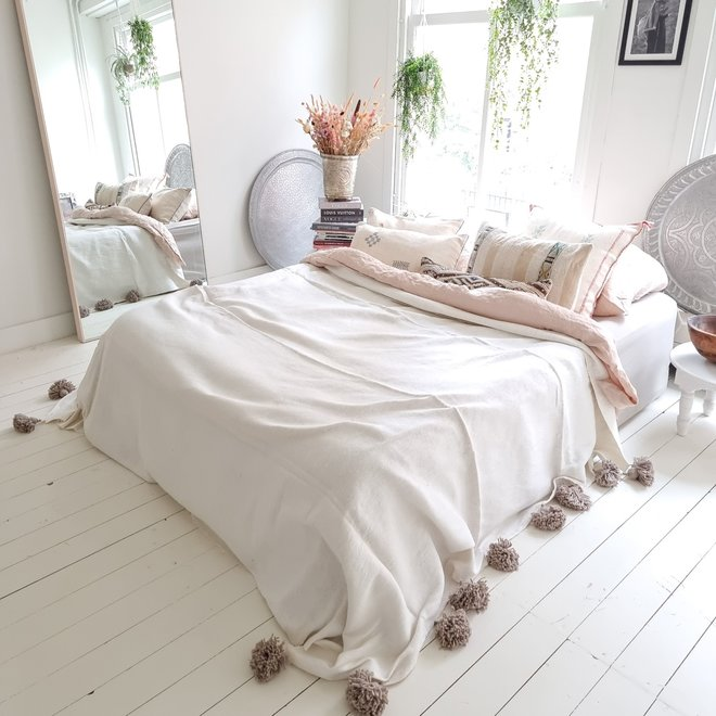 White Moroccan blanket with clay grey pompoms