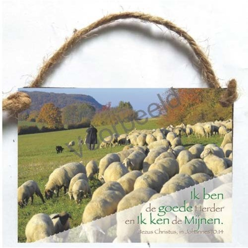 Houten tekstbord met de tekst:Ik ben de goede Herder en Ik ken de Mijnen