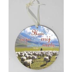 Rond wandbord met de tekst: De Heere is mijn Herder, mij ontbreekt niets.