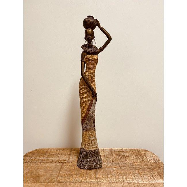 Bali-Dreams Afrikaanse dame met waterkan op hoofd.