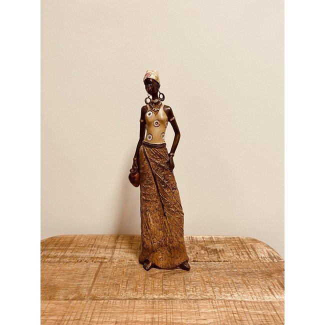 Bali-Dreams Afrikaanse dame met kan.