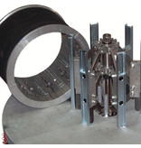 Machine especially designed to easily replace the rubber belts of expander rims