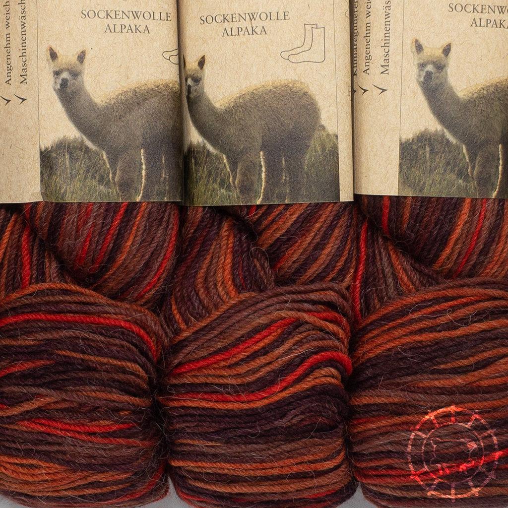 «Apu Kuntur» – Alpaca. Our Passion. Sockenwolle multicolor – Kupfer-Orange