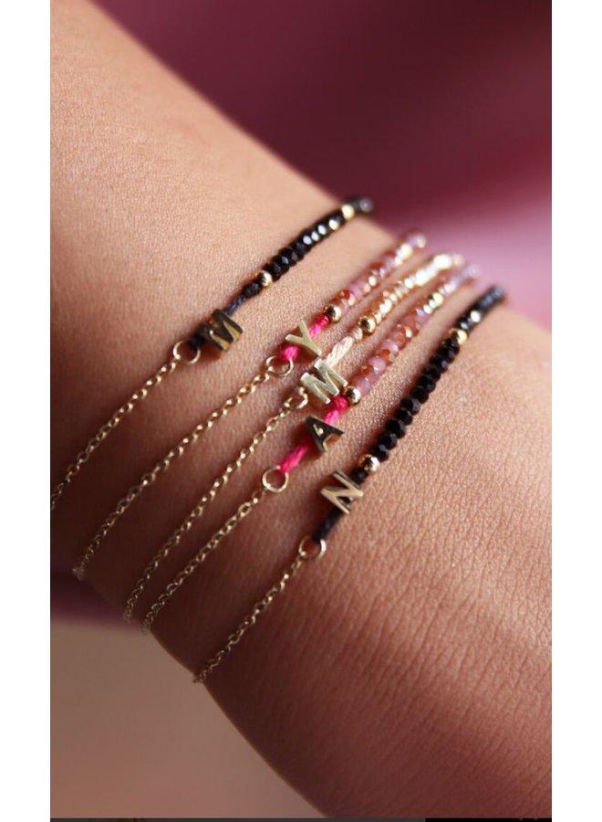 Paarse Kralen armband met initial