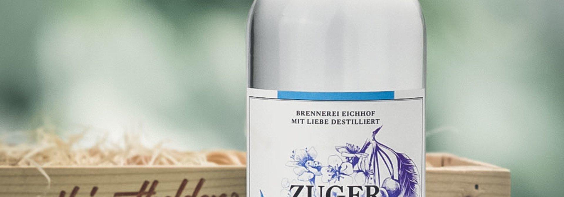 Zuger Kirsch 70cl in attraktiver Geschenk-Holzharasse