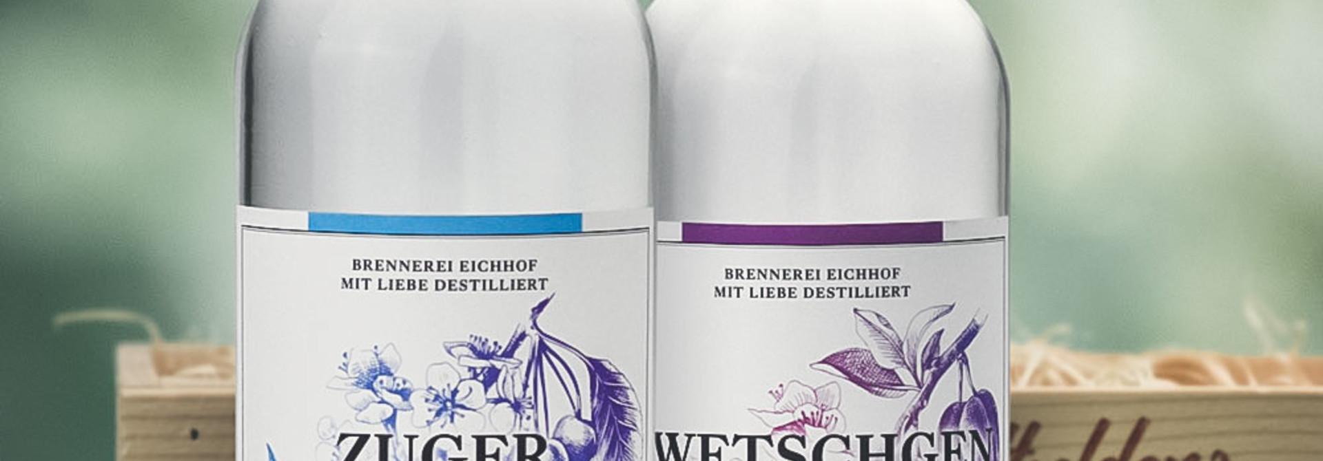 Zuger Kirsch & Zwetschgen Wasser 70cl in Geschenkharasse