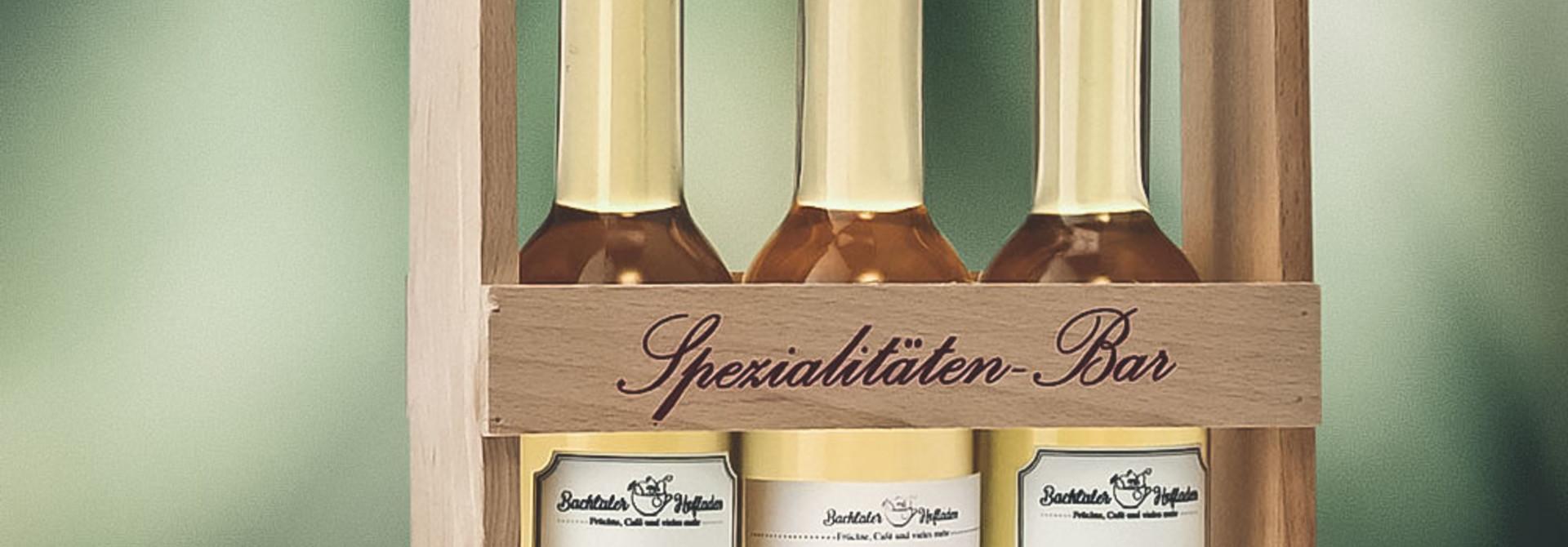 Spezialitäten-Bar «Sie & Er» 20cl Platinflaschen im Holzgestell