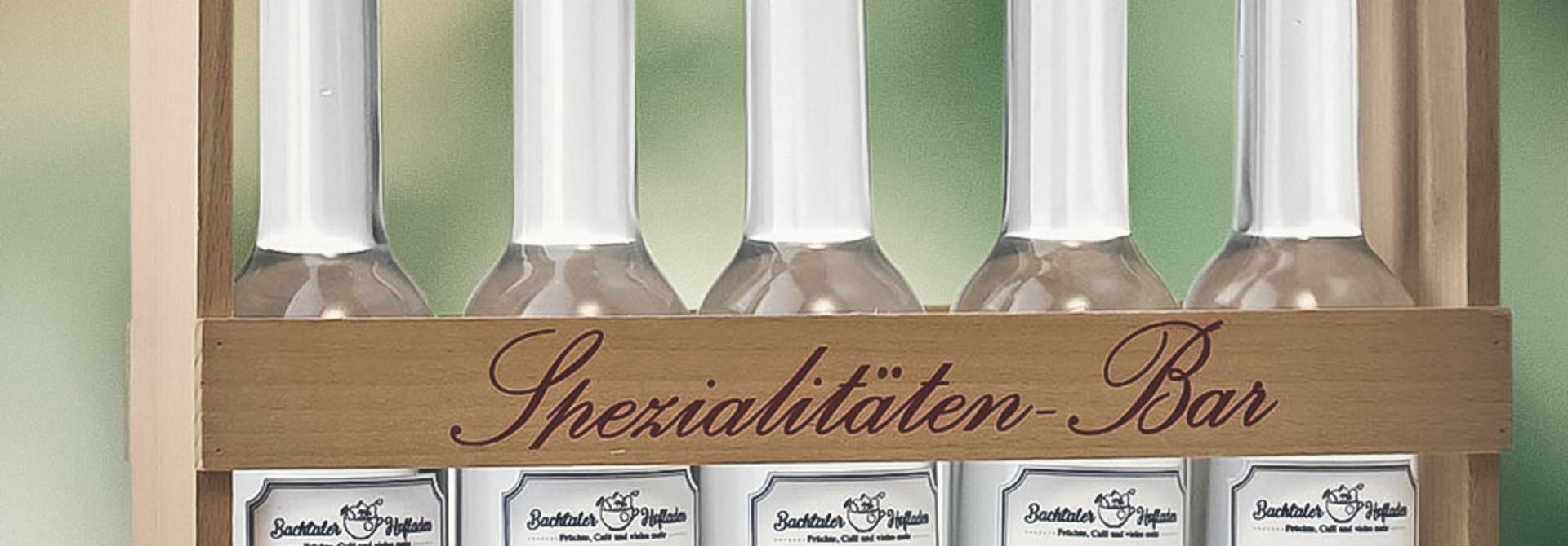 Spezialitäten-Bar «vo allem e chli» 20cl Platinflaschen im Holzgestell
