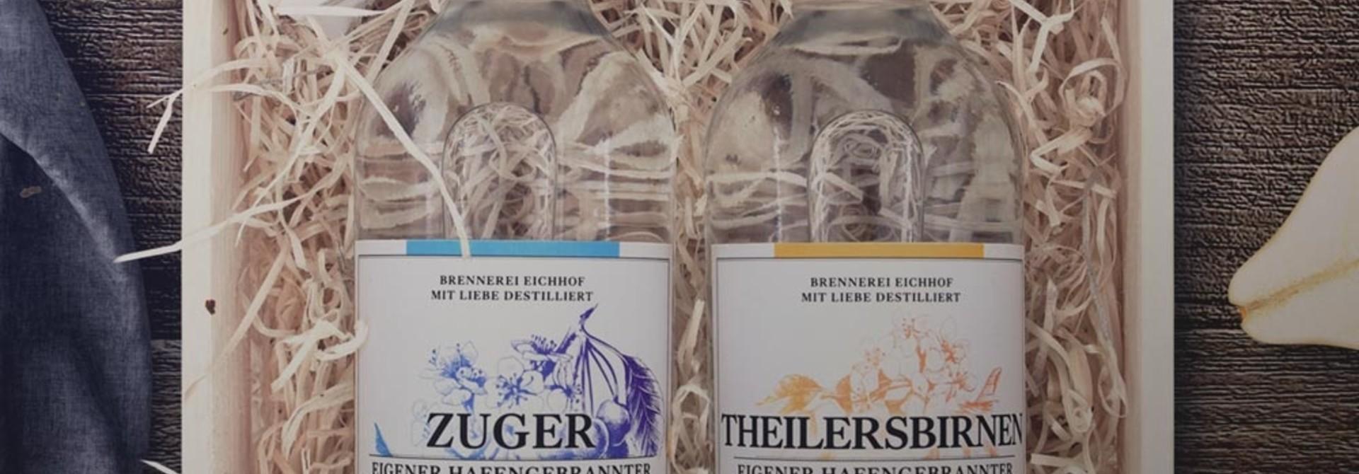 Zuger Kirsch & Theilersbirnen Träsch 70cl in Harasse