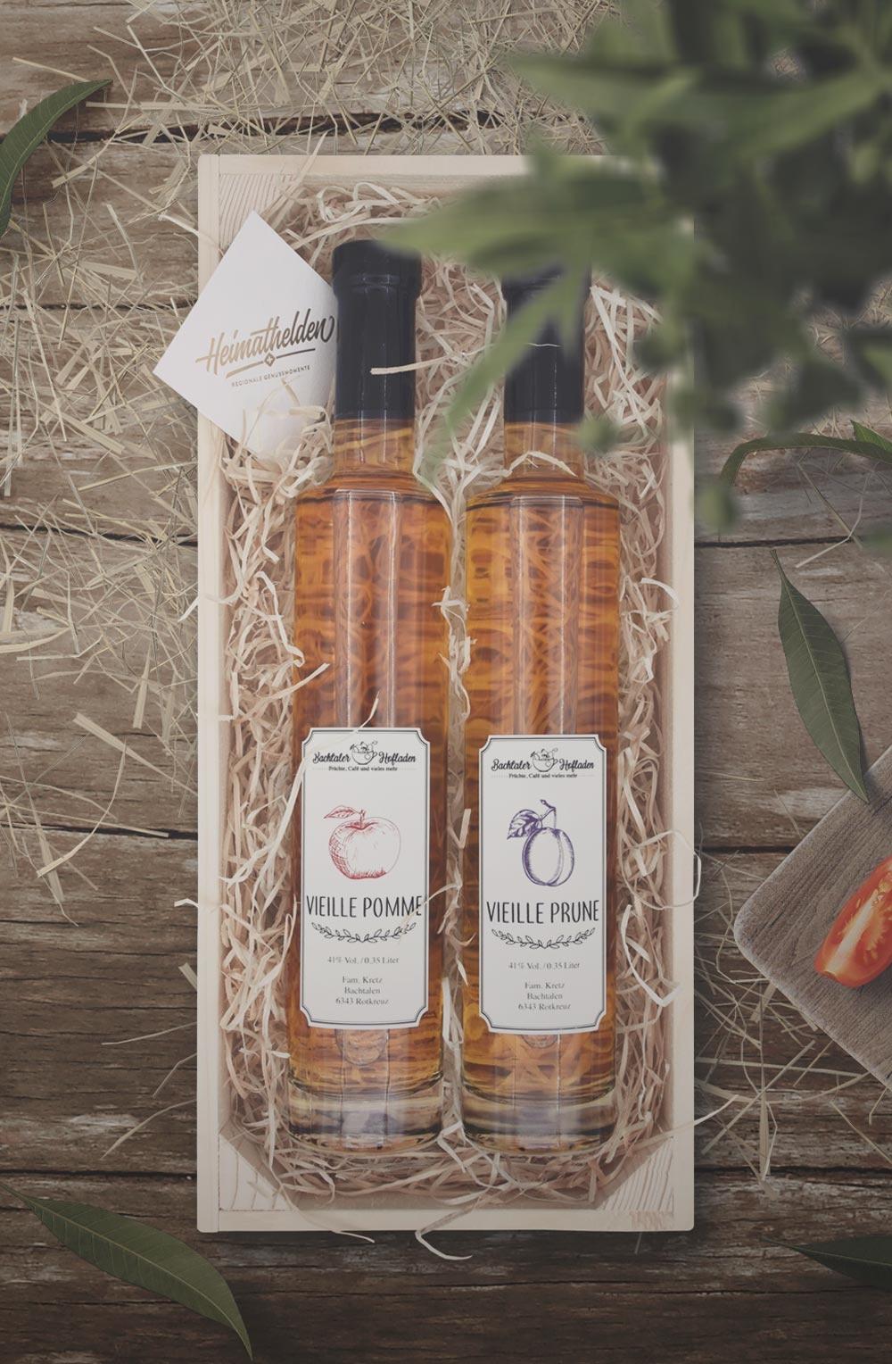 Vieille Prune & Pomme 35cl in schöner Holzharasse-1
