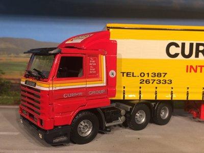 Tekno Tekno Scania 113M streamliner met schuifzeilen oplegger Currie European