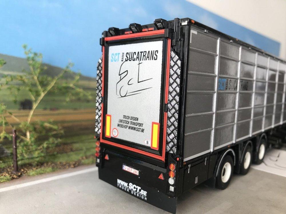 Tekno Tekno Scania S met 3-assige resin vlakke veeoplegger Sucatrans België