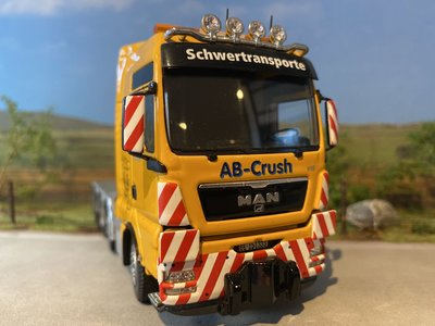 Tekno Tekno MAN TGX XXL 8x4 single truck AB - Crush Zwitserland