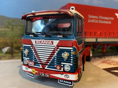 Tekno Tekno Scania 140 with classic curtain side trailer Vogel
