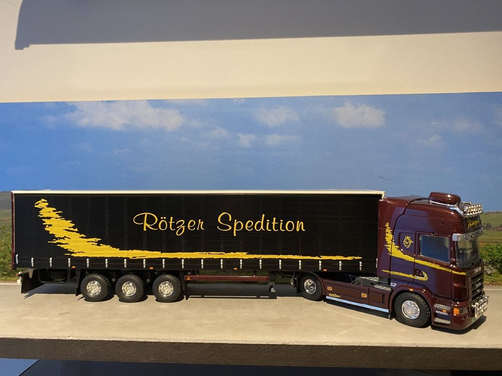 Tekno Tekno Scania R Topline met schuizeilen oplegger Rotzer