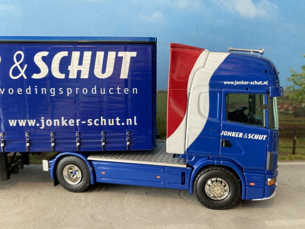 Tekno Tekno Scania 144L Topline met schuif zeilenoplegger Jonker & Schut