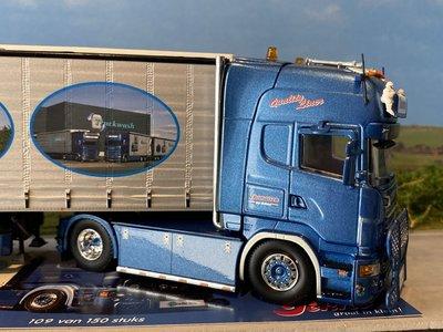 Tekno Tekno Scania R Topline met 3-assige schuifzeilen oplegger Tholu / Thomassen