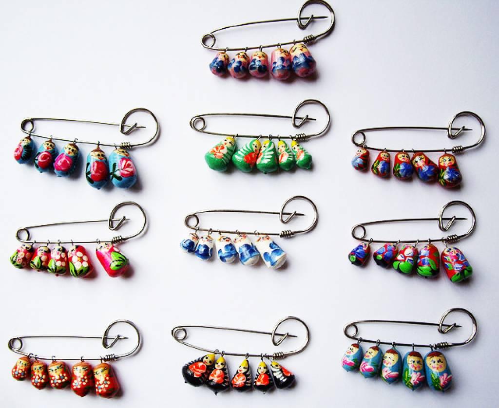 Matryoshka pin, different colors.