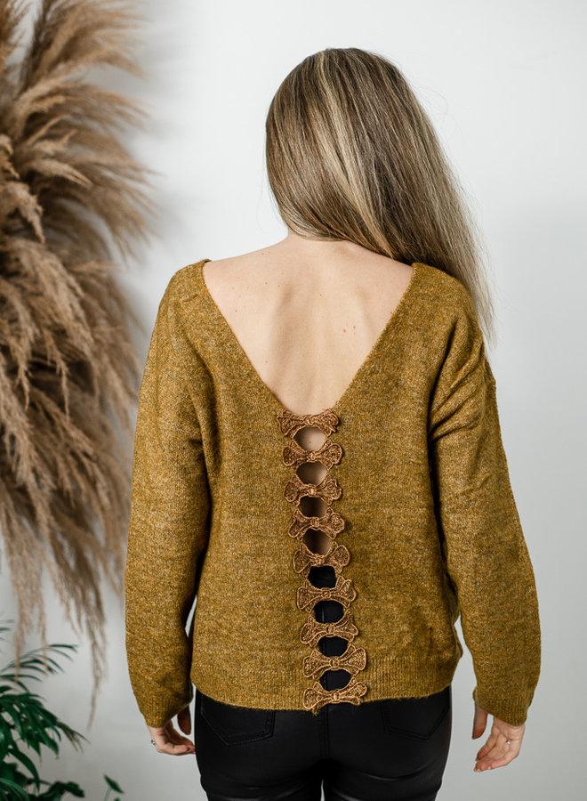 Mosterdgele trui met strikjes op rug