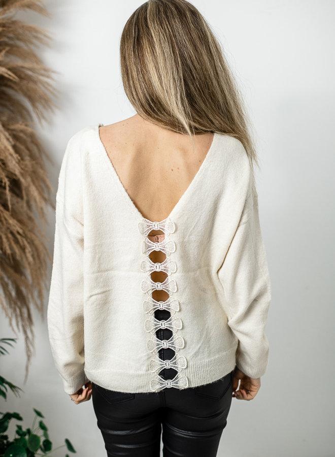 Ecru trui met strikjes op rug