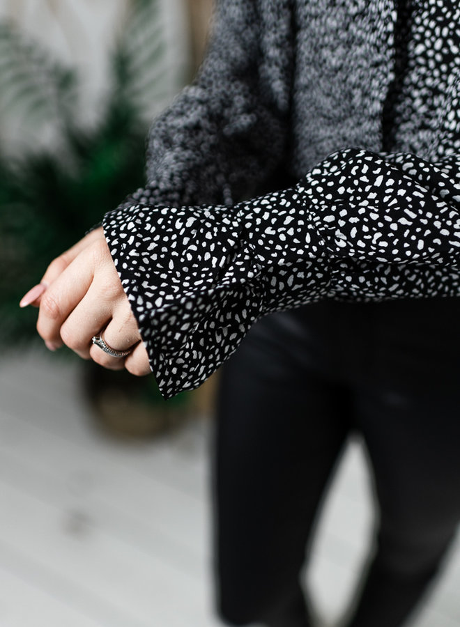 Zwart/witte blouse met ruffles
