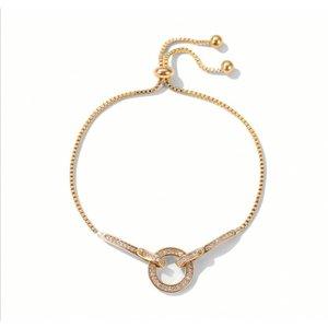 Goudkleurige armband met steentjes
