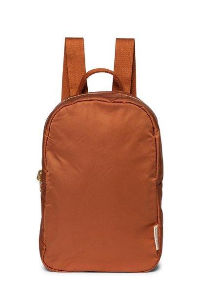 Rust puffy backpack
