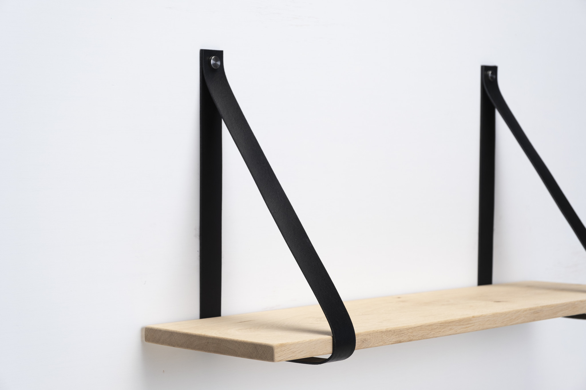 Wall shelf for leather carriers