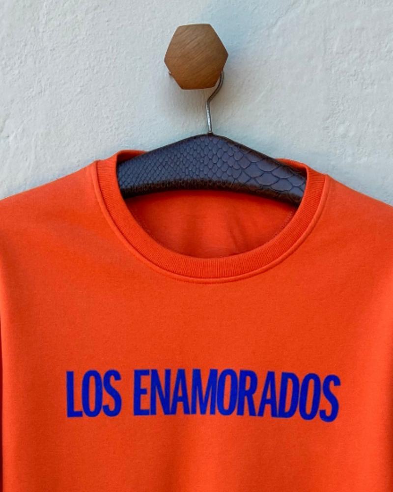 Los Enamorados Orange Sweater with Sky Blue Velvet Logo